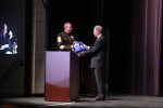 John Moon presents the 1st Sgt with a thank you gift